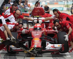 Crew members work on the car of Ferrari driver Kimi Raikkonen of Finland during the second practice session for Sunday's Malaysian Formula One Grand Prix at Sepang International Circuit in Sepang, Malaysia, Friday, March 28, 2014. (AP Photo/Lai Seng Sin)